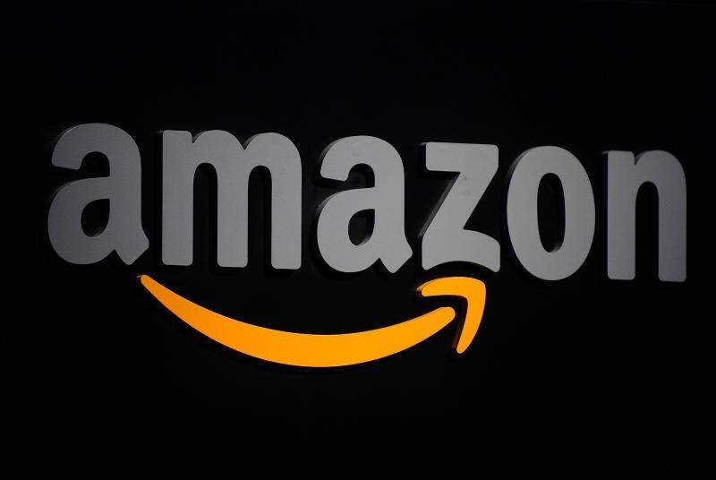 The Amazon logo is seen on a podium duri
